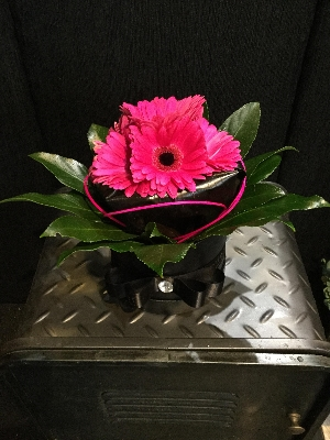 Black gloss hat box with cerise Gerbera finish
