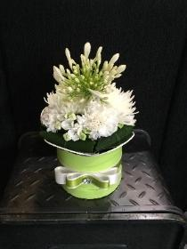 Lime green hat box with white floral finish