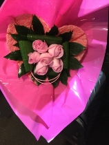 6 pink roses in a pink heart shaped holder