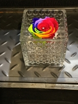 Everlasting rainbow rose in chunky handmade dimpled glass vase