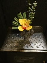 Funky cactus vase with yellow orchid and eucalyptus finish